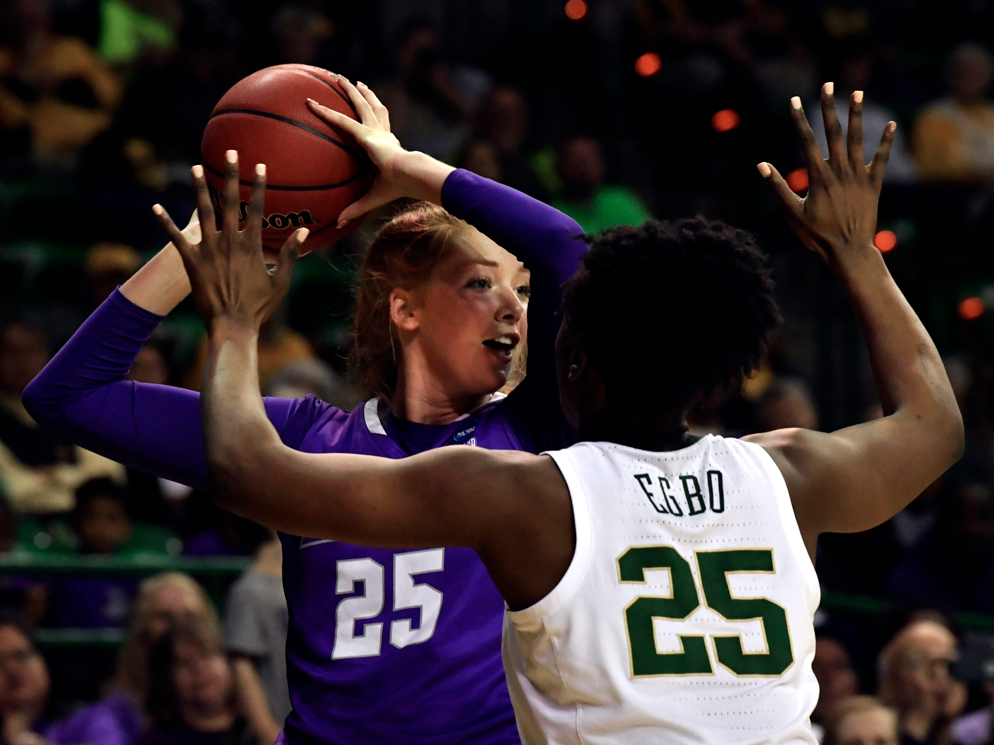 ACU center Lexi Kirgan looks for an opening past Baylor's Queen Egbo during Saturday's NCAA Tournament women's round 1 basketball game March 23, 2019. Baylor defeated Abilene Christian University, 95-38.