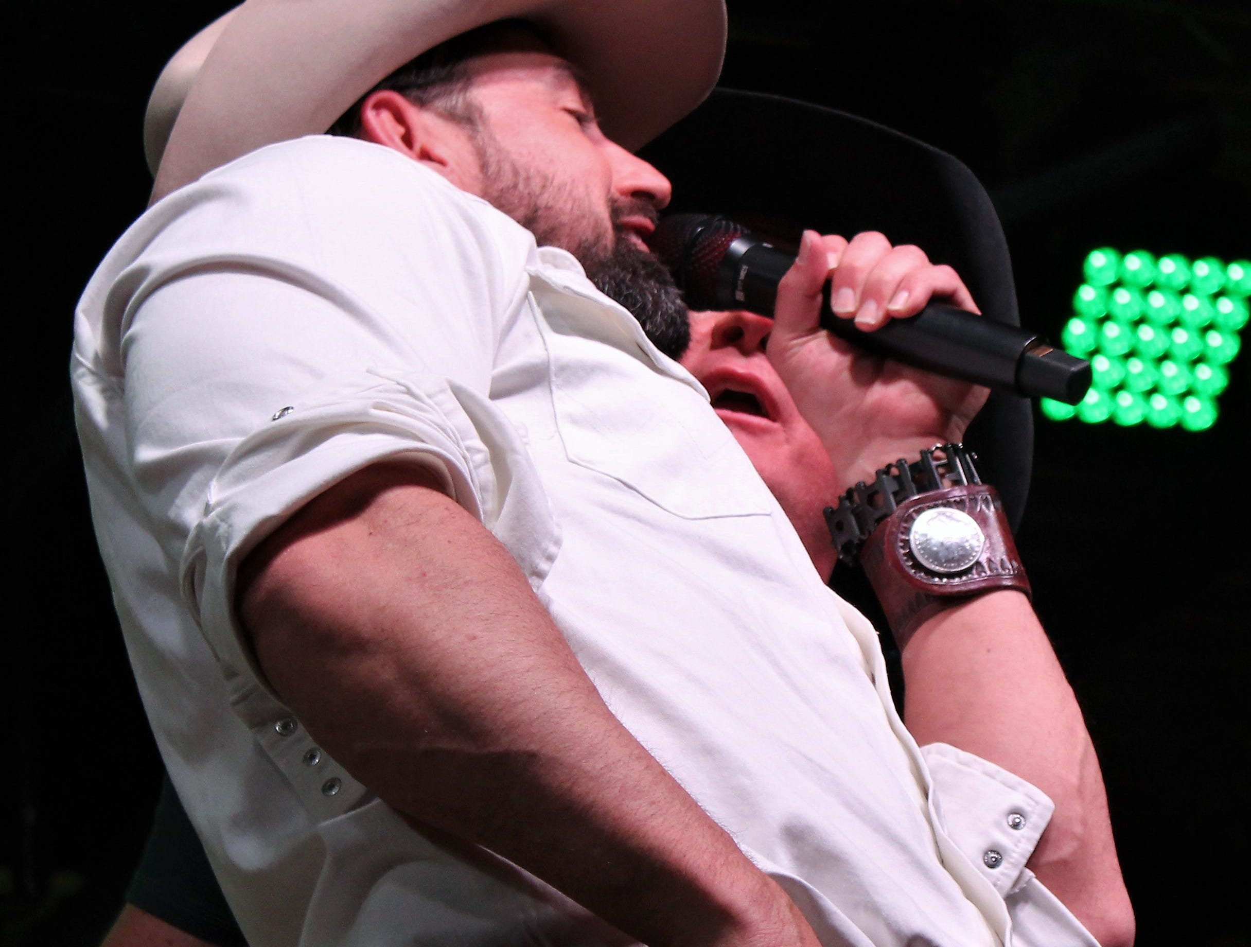 Kevin Fowler and Mark Powell, left, duet toward the end of Powell's set Saturday evening March 23, 2019, at the 9th Outlaws & Legends Music Festival.