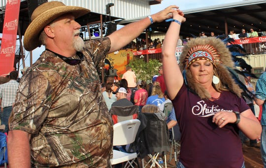 Shawn and Rhonda Cunningham of Iowa Park whirl and twirl to the music of Kevin Fowler on Saturday afternoon at the Back Porch of Texas.