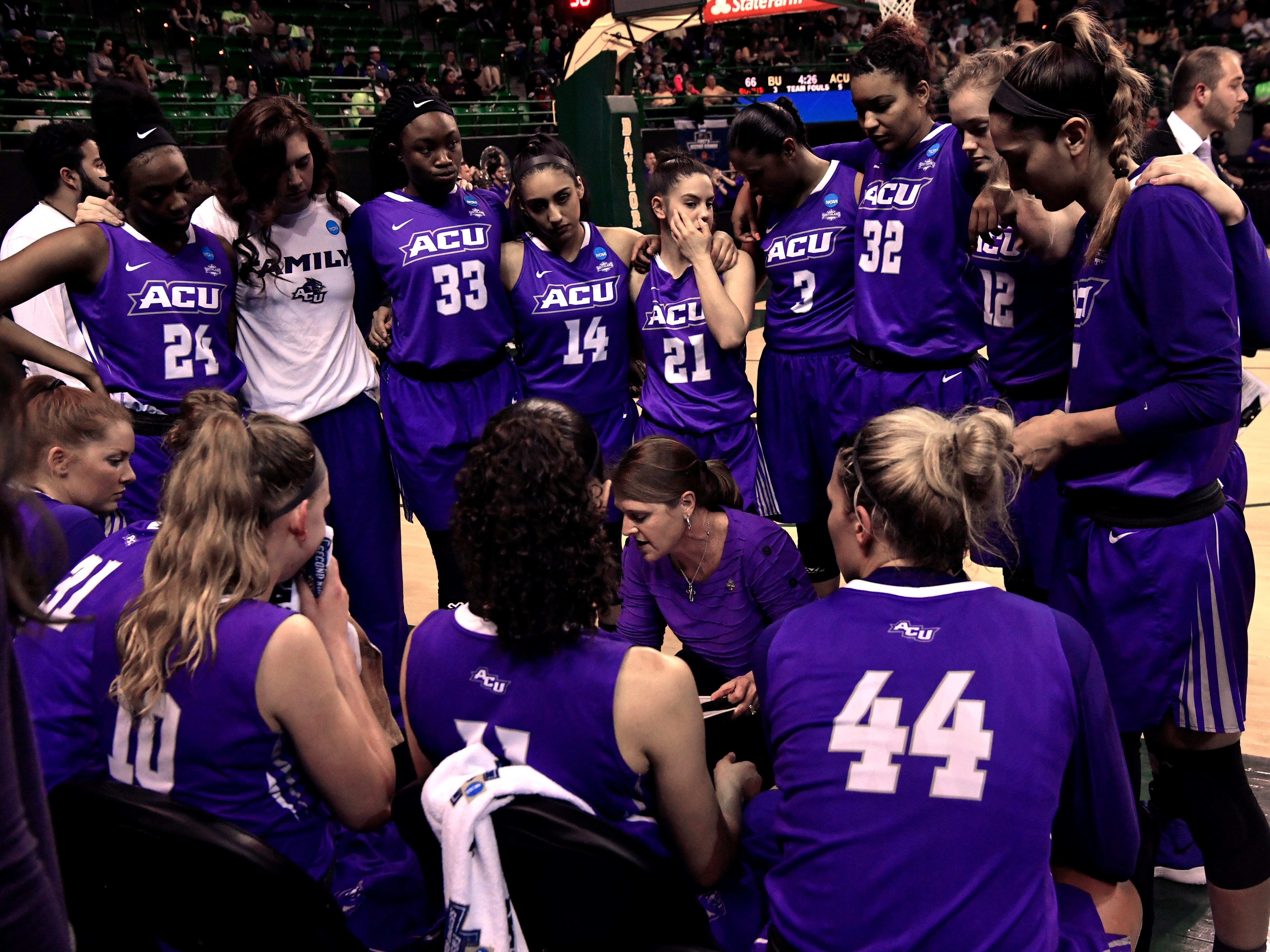 The ACU women's basketball team huddles early in the second half of Saturday's NCAA Tournament women's round 1 basketball game March 23, 2019. Baylor defeated Abilene Christian University, 95-38.