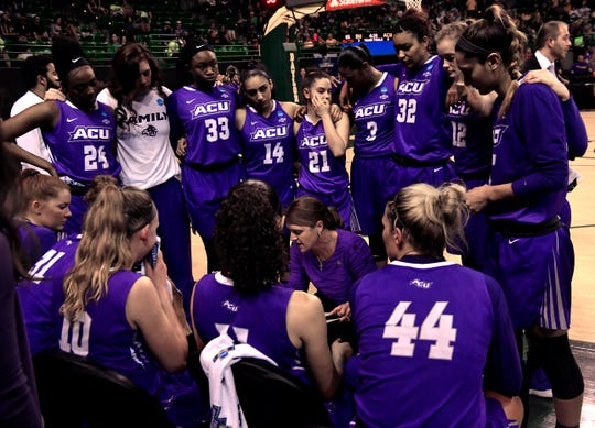 The ACU women's basketball team huddles early in the second half of Saturday's NCAA Tournament women's round 1 basketball game.