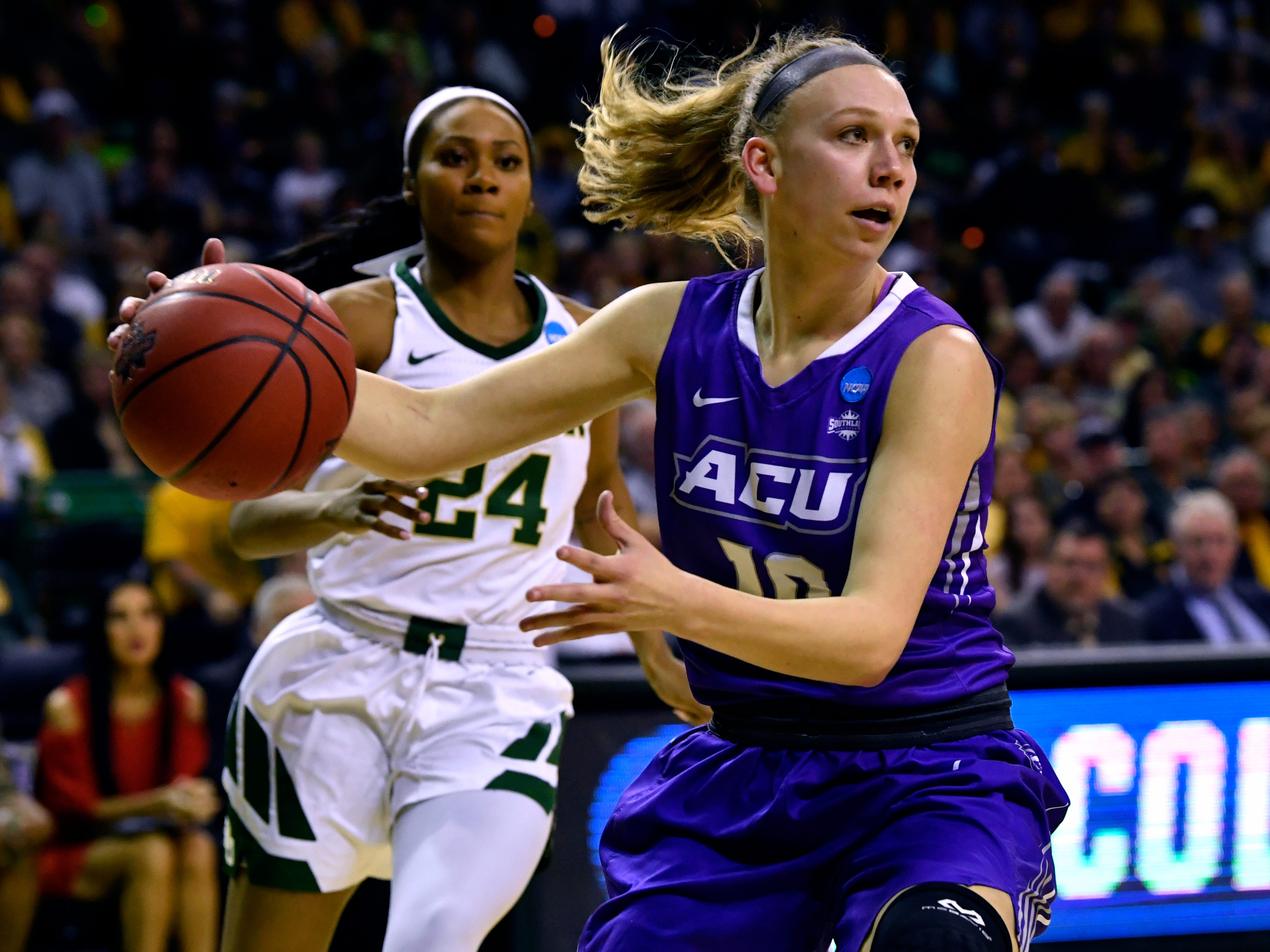 ACU's Breanna Wright plays below the net during Saturday's NCAA Tournament women's round 1 basketball game March 23, 2019. Baylor defeated Abilene Christian University, 95-38.