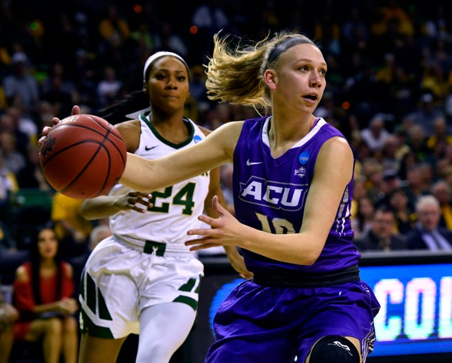 ACU's Breanna Wright plays below the net during the Wildcats' game against Baylor in the first round of the NCAA Tournament. Baylor won 95-38 on March 23 in Waco.