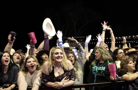 Midland fans, with women in the majority, cheer the Texas trio during the band's headlining performance Friday evening at the 9th Outlaws & Legends Music Festival.
