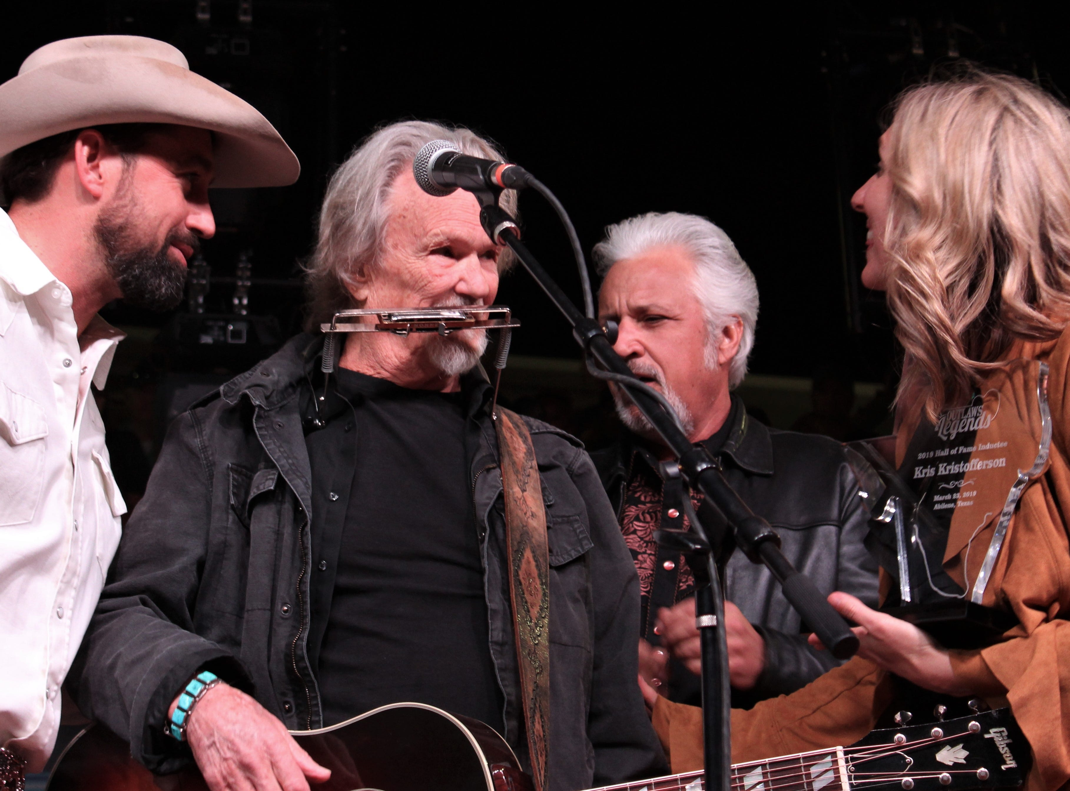 From left, Mark Powell, Kristofferson, Scott Joss and Meredith Powell when Kristofferson is honored with induction to the hall of fame Saturday evening March 23, 2019, at the 9th Outlaws & Legends Music Festival.