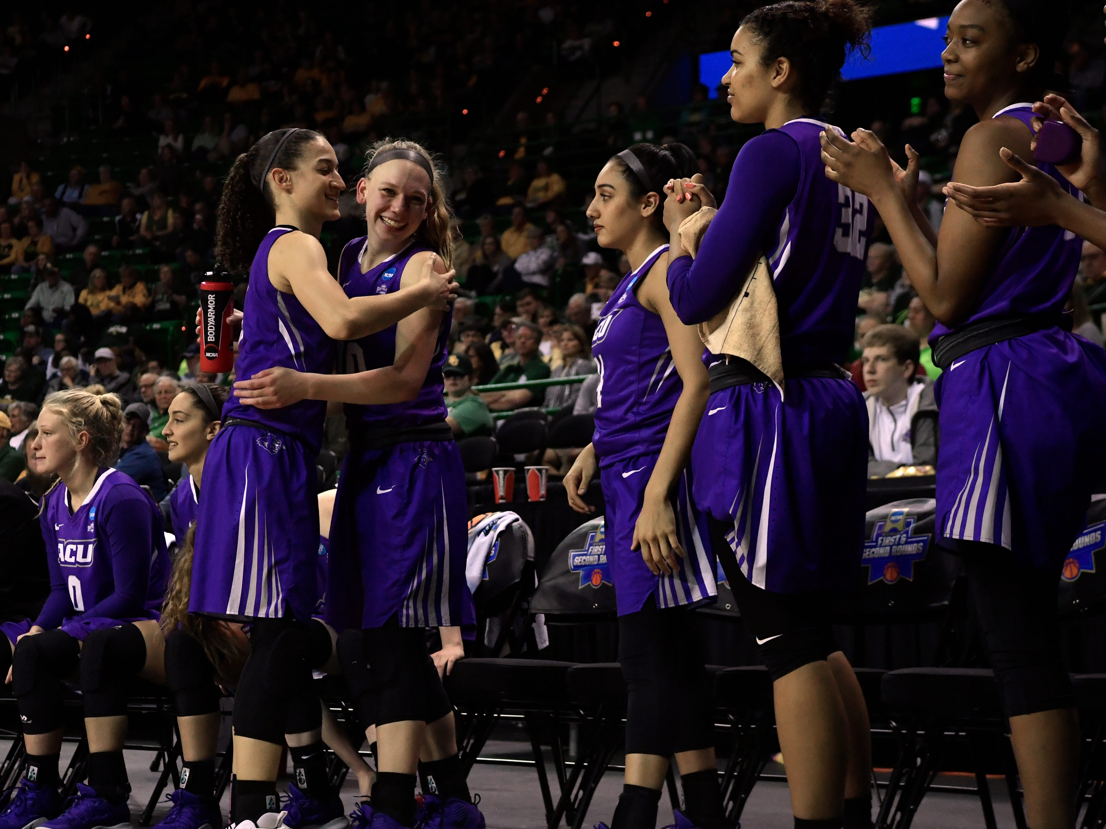 Sara Williamson embraces Breanna Wright, as she goes down the line, expressing her appreciation for her teammates on the ACU bench before the end of Saturday's NCAA Tournament women's round 1 basketball game March 23, 2019. Baylor defeated Abilene Christian University, 95-38.