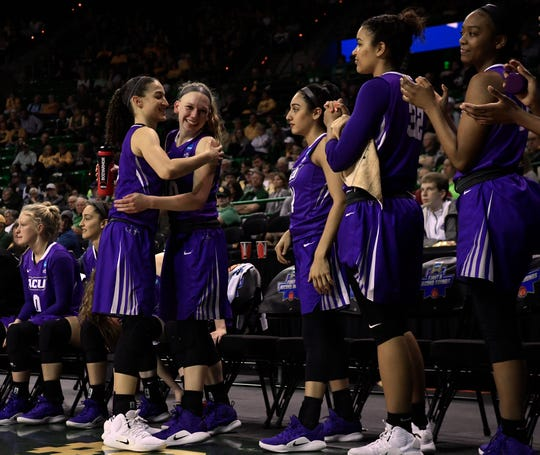 Sara Williamson embraces Breanna Wright, as she goes down the line, expressing her appreciation for her teammates on the ACU bench before the end of Saturday's NCAA Tournament women's round 1 basketball game. Baylor defeated Abilene Christian University, 95-38.