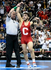 Mar 23, 2019; Pittsburgh, PA, USA; Cornell wrestler Yianni Diakomihalis (red) reacts after defeating Ohio State wrestler Joey McKenna (not pictured) in the finals of the 141 pound weight class during the NCAA Wrestling Championships at PPG Paints Arena. Mandatory Credit: Douglas DeFelice-USA TODAY Sports