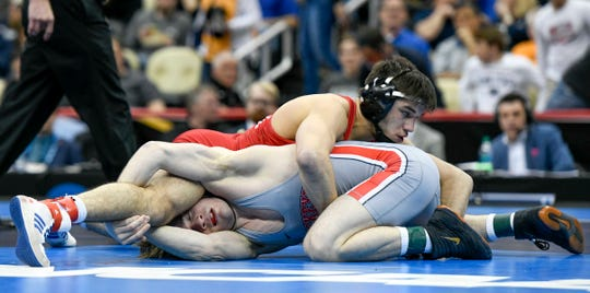 Mar 23, 2019; Pittsburgh, PA, USA; Cornell wrestler Yianni Diakomihalis (red) wrestles Ohio State wrestler Joey McKenna (grey) in the finals of the 141 pound weight class during the NCAA Wrestling Championships at PPG Paints Arena. Mandatory Credit: Douglas DeFelice-USA TODAY Sports