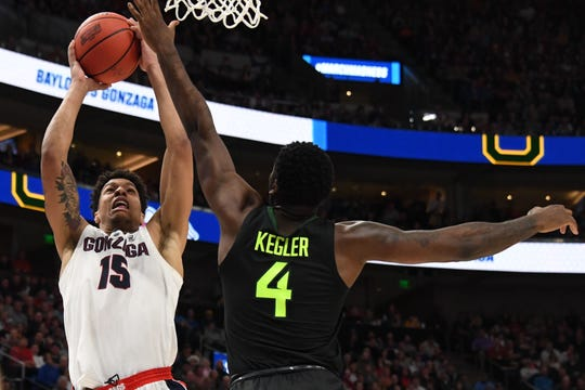 Gonzaga Bulldogs forward Brandon Clarke (15) shoots as Baylor Bears guard Mario Kegler (4) defends during the second half in the second round of the 2019 NCAA Tournament.