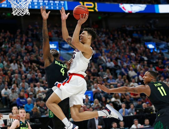 Gonzaga forward Brandon Clarke, center, goes to the basket as Baylor's Mario Kegler (4) and Mark Vital (11) defend during the second half of a second-round game in the NCAA men's college basketball tournament Saturday, March 23, 2019, in Salt Lake City.