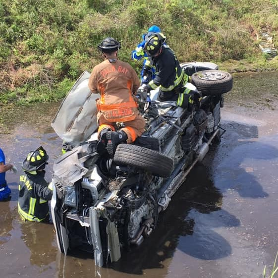 Vehicle lands in pond after rollover crash near Palm Bay; second motorists also assisted