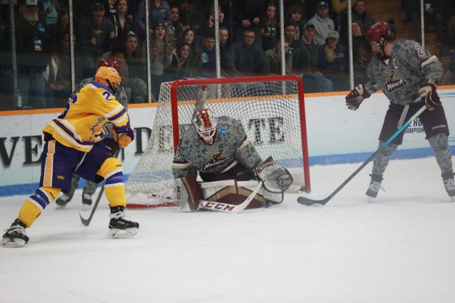 Norwich goalie Tom Aubrun makes one of his 42 saves during the NCAA Division III men's hockey championship game vs. UW-Stevens Point in Stevens Point, Wisconsin on Saturday night. The Cadets lost in overtime.