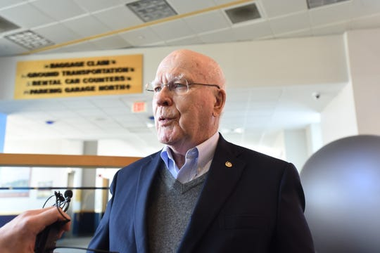 Sen. Patrick Leahy, D-Vt., speaks to reporters on Sunday, March 24, 2019, at the Burlington International Airport in South Burlington.