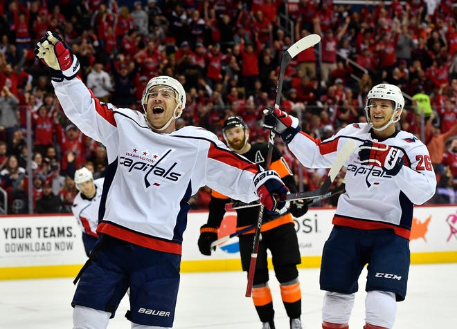 Travis Boyd, left, scored the game-winning goal in the Washington Capitals' 3-1 win over the Flyers Sunday afternoon.