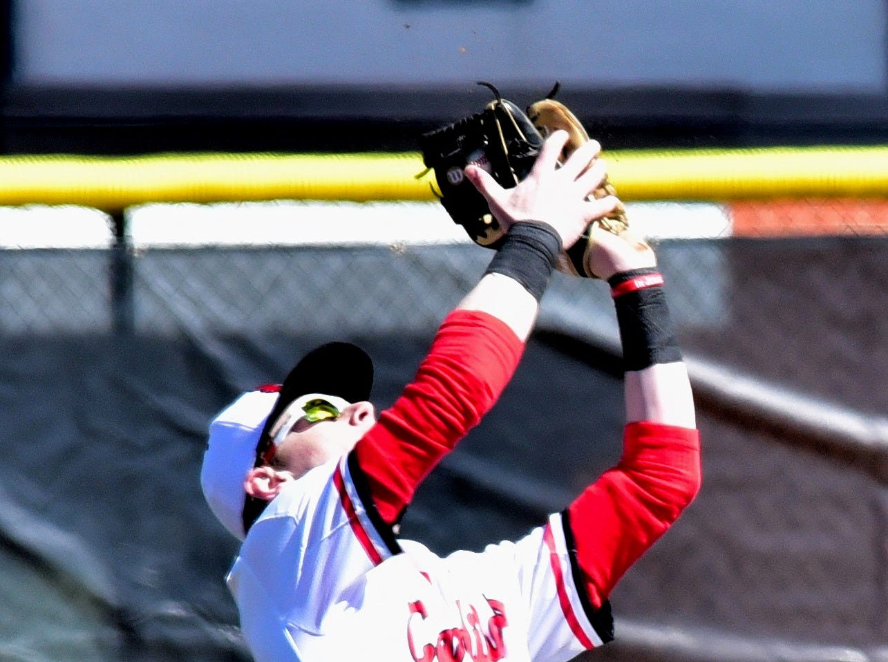 Colerain's Stephen Stigler bags a pop fly for an out for the Cardinals at Colerain High School, March 23, 2019.