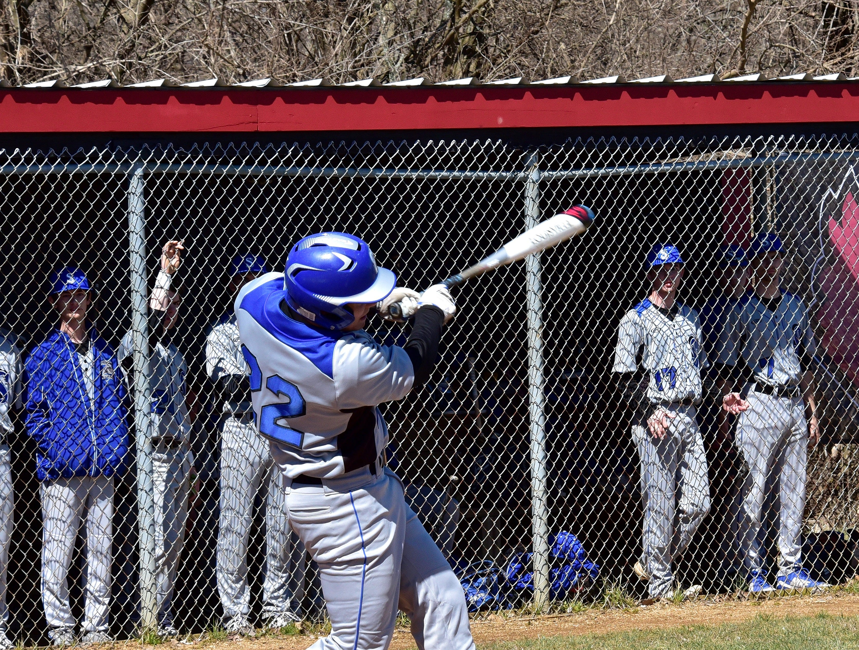 Springboro's Calvin Walters finishes off a homerun swing for the Panthers at Colerain High School, March 23, 2019.