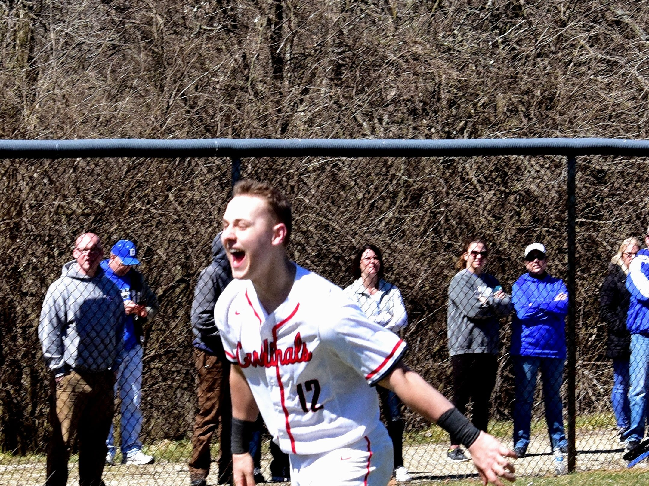 Colerain's Luke Murray is all smiles as he rounds third and heads to home after his game-winning walk-off home run at Colerain High School, March 23, 2019.