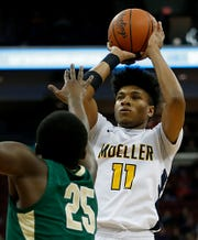 Moeller guard Miles McBride shoots over St. Vincent-St. Mary forward Keyshawn Jonesy during their Division I state final at the Schottenstein Center in Columbus Saturday, March 23, 2019. Moeller won 52-44.