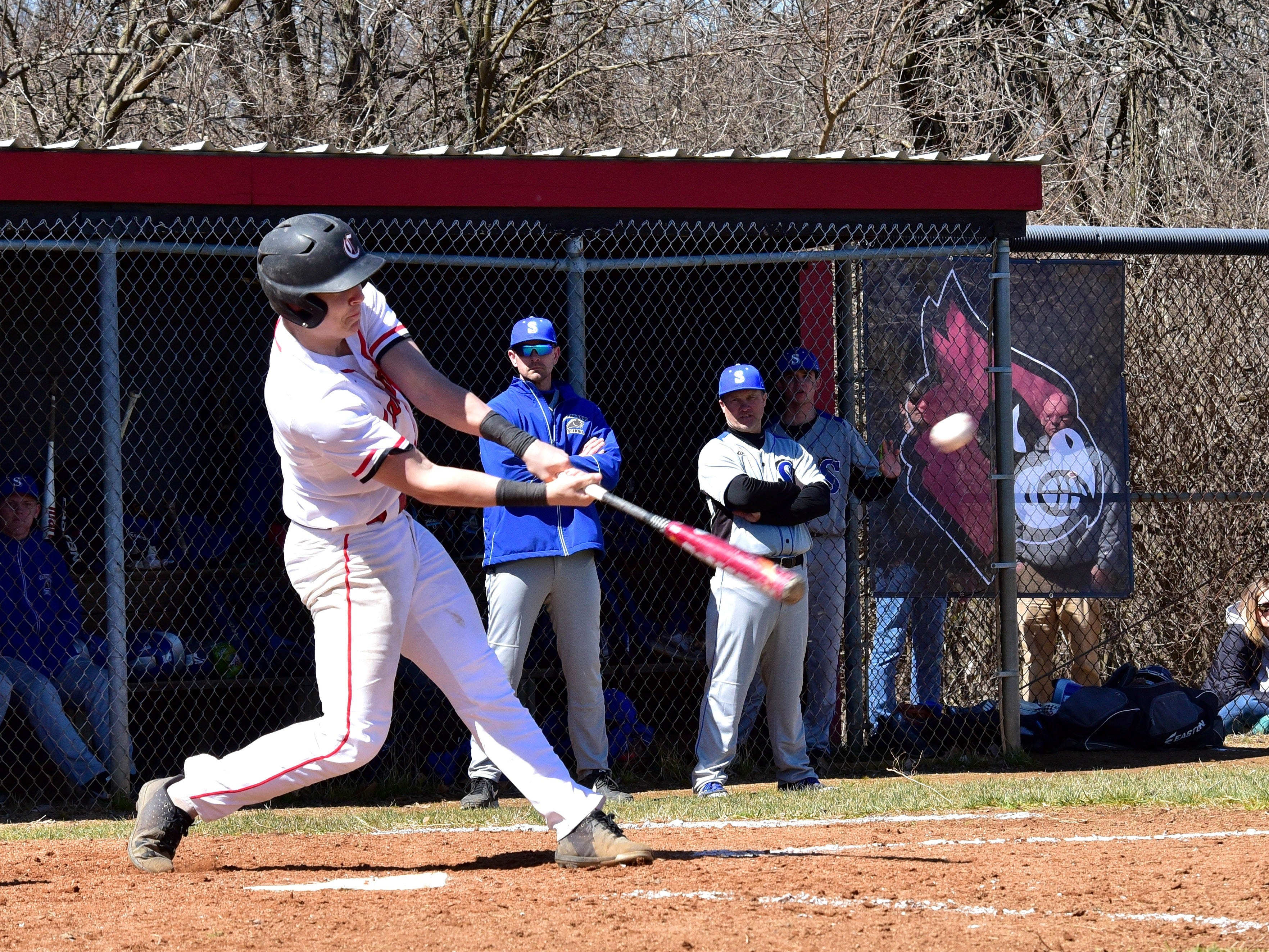 Luke Murray of Colerain launches a solo walk off homerun as the Cardinals top Springboro on opening day of high school baseball in Cincinnati at Colerain High School, March 23, 2019.