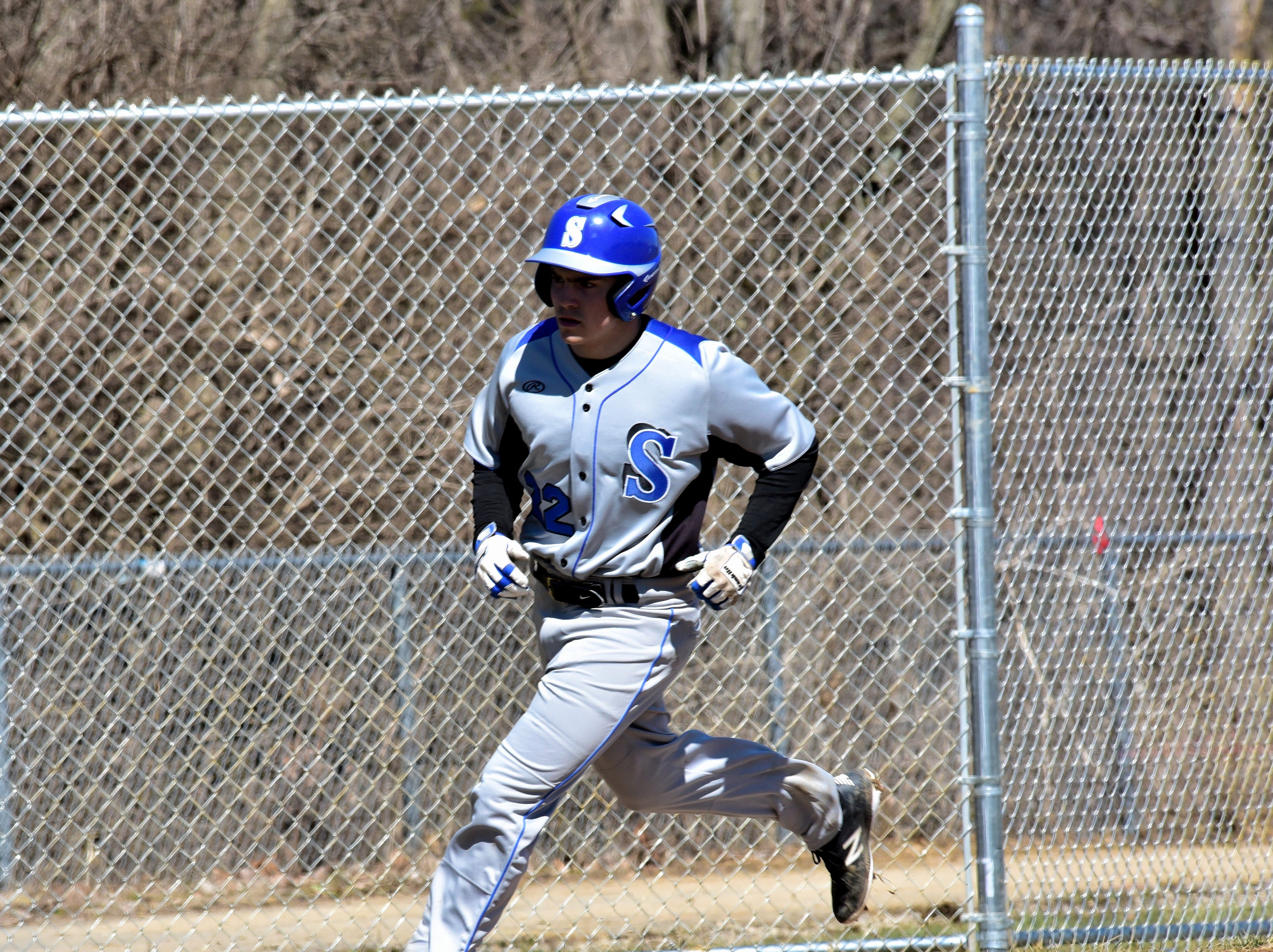 Calvin Walters rounds third base on his way to home plate after belting a solo shot to put Springboro on the board on opening day at Colerain High School, March 23, 2019.