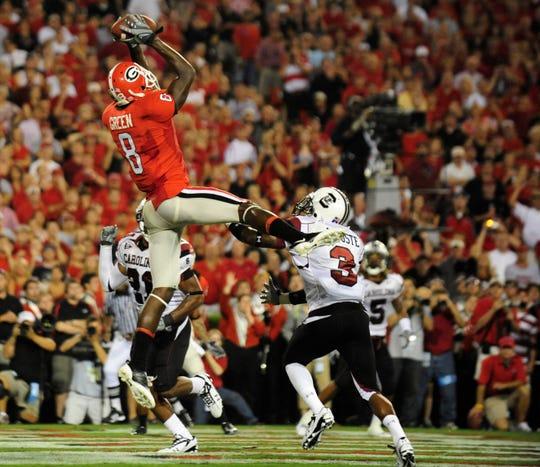 September 12, 2009; Athens, GA, USA; Georgia Bulldogs WR A.J. Green (8) catches a touchdown pass behind the South Carolina defense.