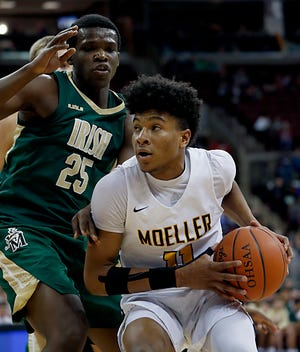 Moeller guard Miles McBride is covered by St. Vincent-St. Mary forward Keyshawn Jones during their Division I state final at the Schottenstein Center in Columbus Saturday, March 23, 2019. Moeller won 52-44.
