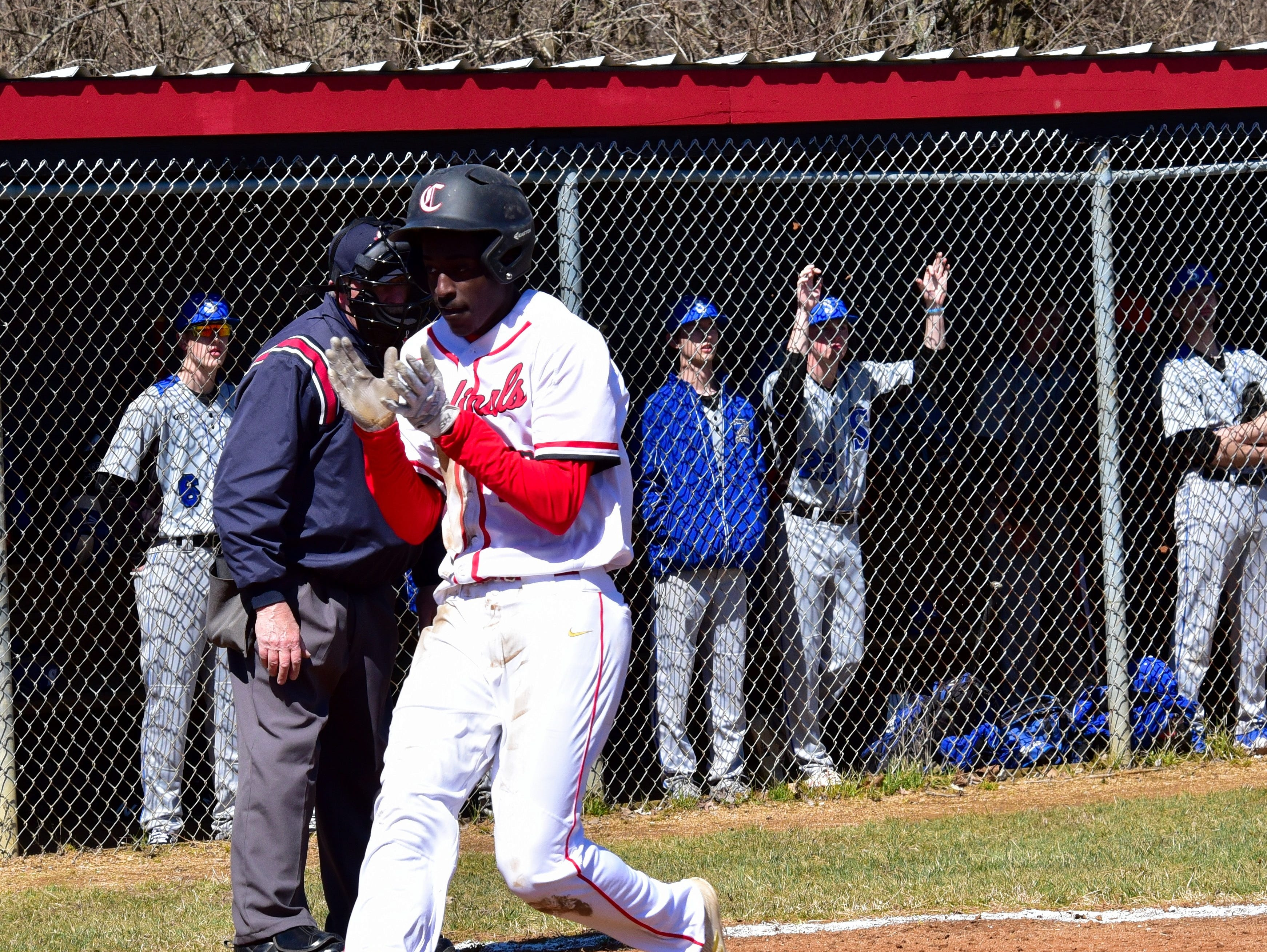 Colerain's Christian Robinson plates the first run of the season for the Cardinals at Colerain High School, March 23, 2019.