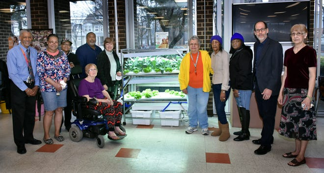 Members of the Richmond Towers Garden Club welcome Freeholder Chair Bette Jane Kowalski to their new hydroponic garden in the community room of the Richmond Towers senior residential complex in Plainfield. The garden was funded through a grant from the Freeholder Board's Union County Means Green Community Garden grant program. Pictured here are (left to right) Richmond Towers Program Director Darryl Clark;Garden Club members Michele Taylor, Valerie Stankowitz, and Perla Blanco;Plainfield Housing Authority Executive Director Randall Wood, Union County Freeholder Chair Bette Jane Kowalski, Garden Club members Lorraine MacNamara, Gladys Jackson and Sheila Jackson;Groundwork Elizabeth Executive Director Jonathan Phillips, and Garden Club member Estella Rivera.