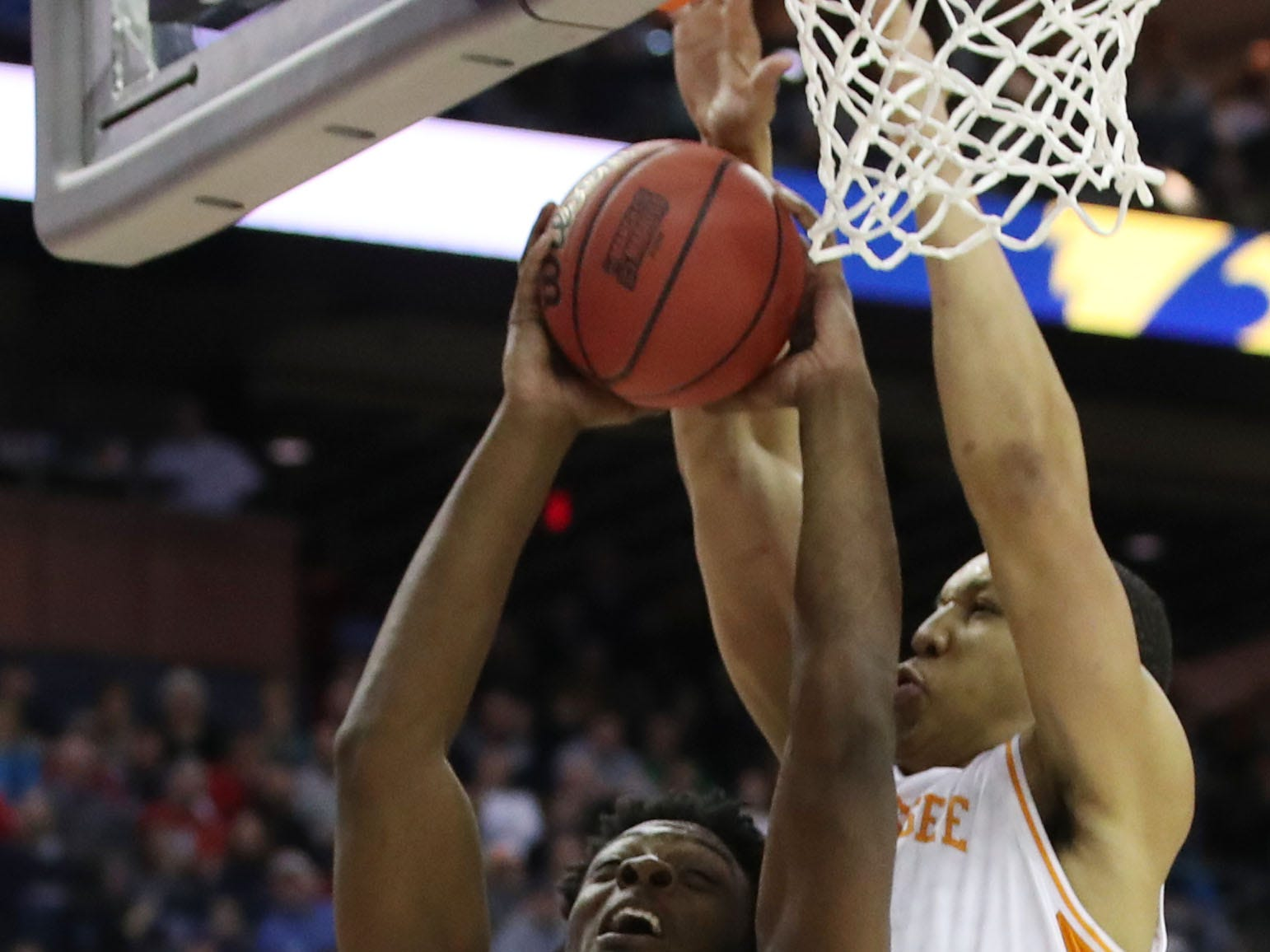 Iowa Hawkeyes forward Tyler Cook (25) goes to the basket defended by Tennessee Volunteers forward Grant Williams (2) in the second half in the second round of the 2019 NCAA Tournament at Nationwide Arena.