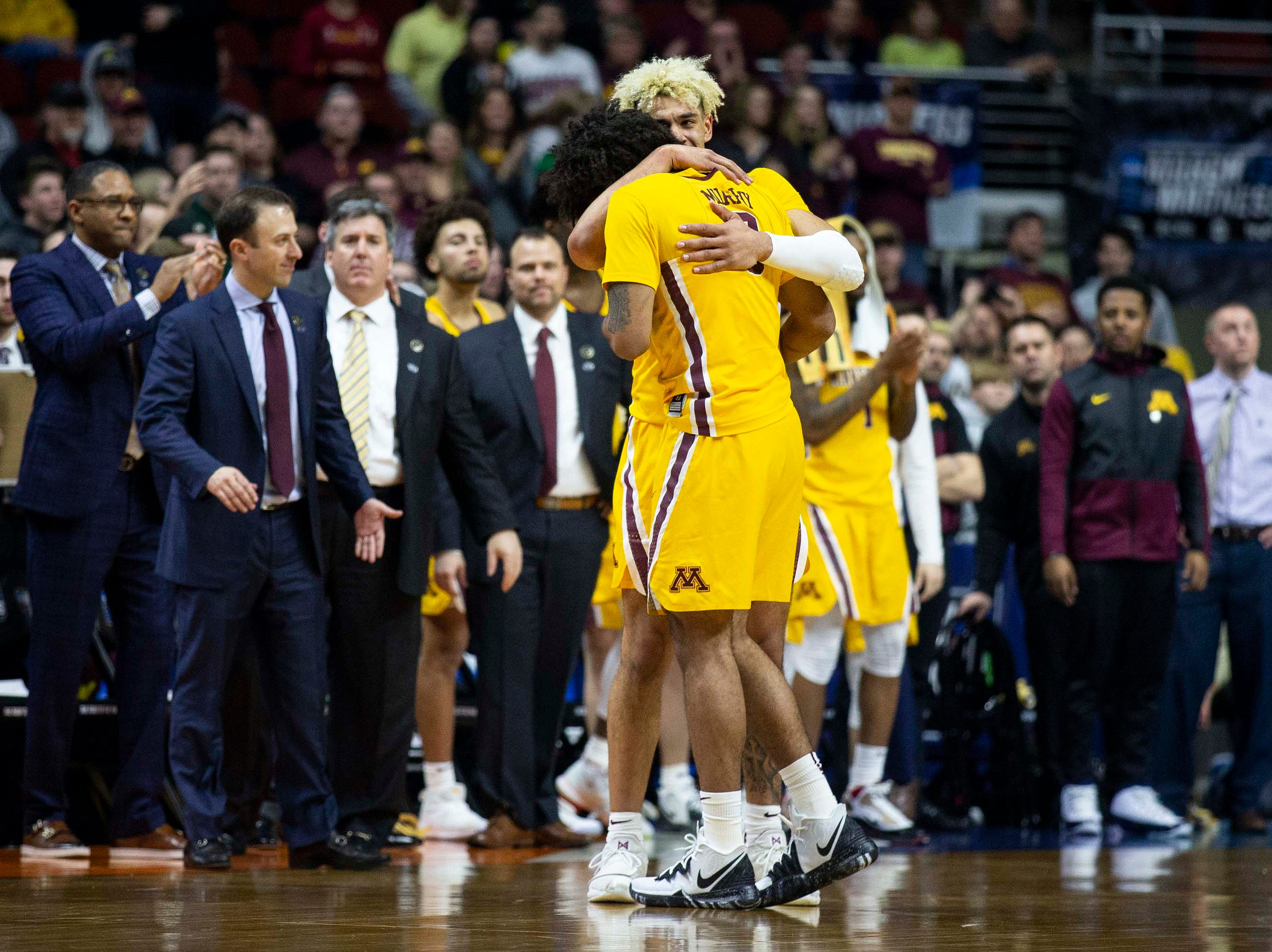 Minnesota's Jordan Murphy gets a hug from Minnesota's Jarvis Omersa as he checks out out of the game for the last time during the NCAA Tournament second-round match-up between Minnesota and Michigan State on Saturday, March 23, 2019, in Wells Fargo Arena in Des Moines, Iowa.
