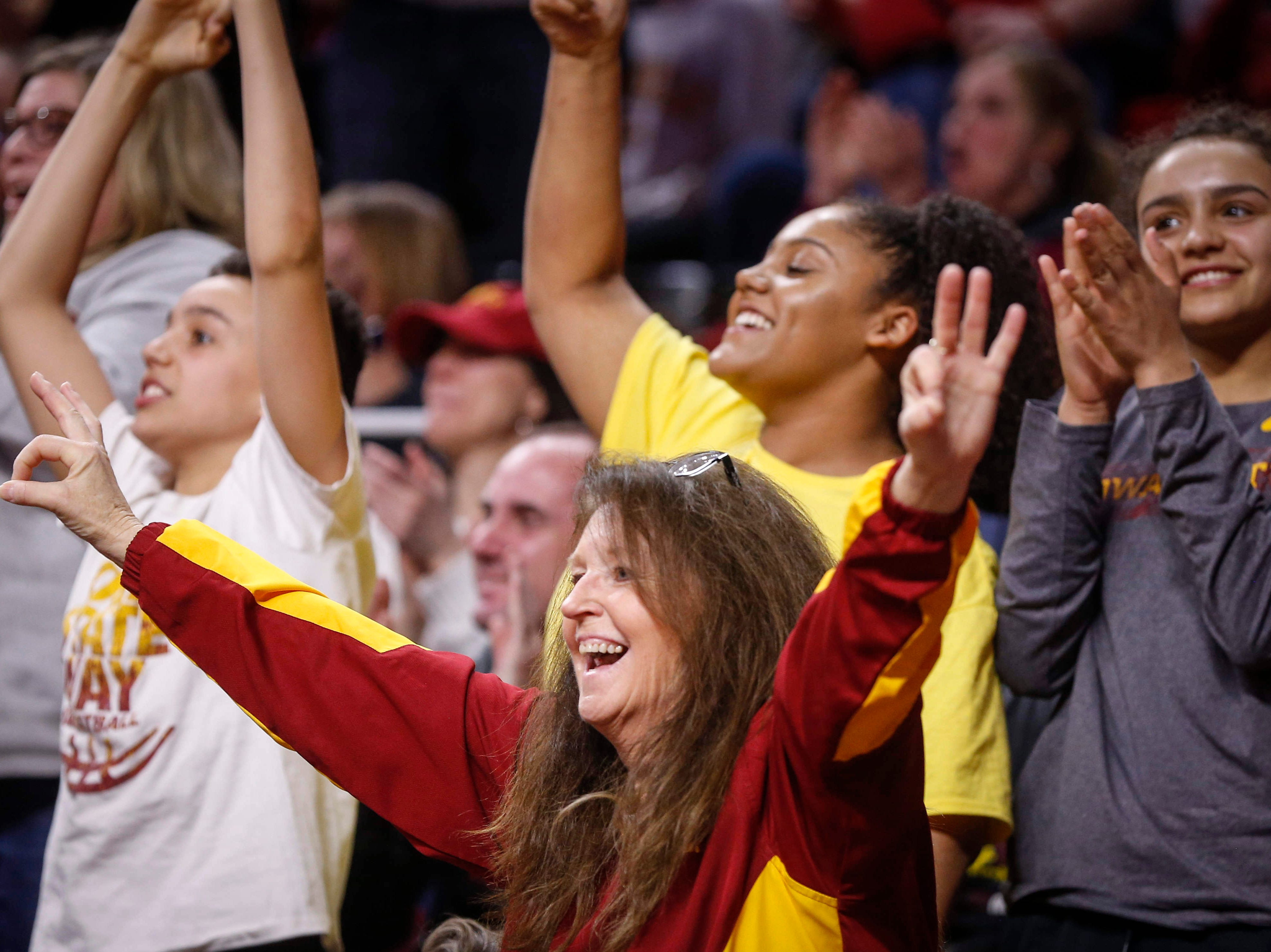 Iowa State fans cheer in the third quarter as the Cyclone women's basketball team extended its lead over New Mexico State on Saturday, March 23, 2019, at Hilton Coliseum in Ames.
