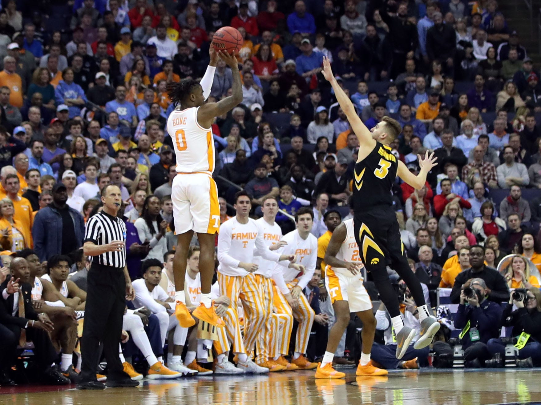 Tennessee Volunteers guard Jordan Bone (0) shoots the ball over Iowa Hawkeyes guard Jordan Bohannon (3) in overtime  in the second round of the 2019 NCAA Tournament at Nationwide Arena.