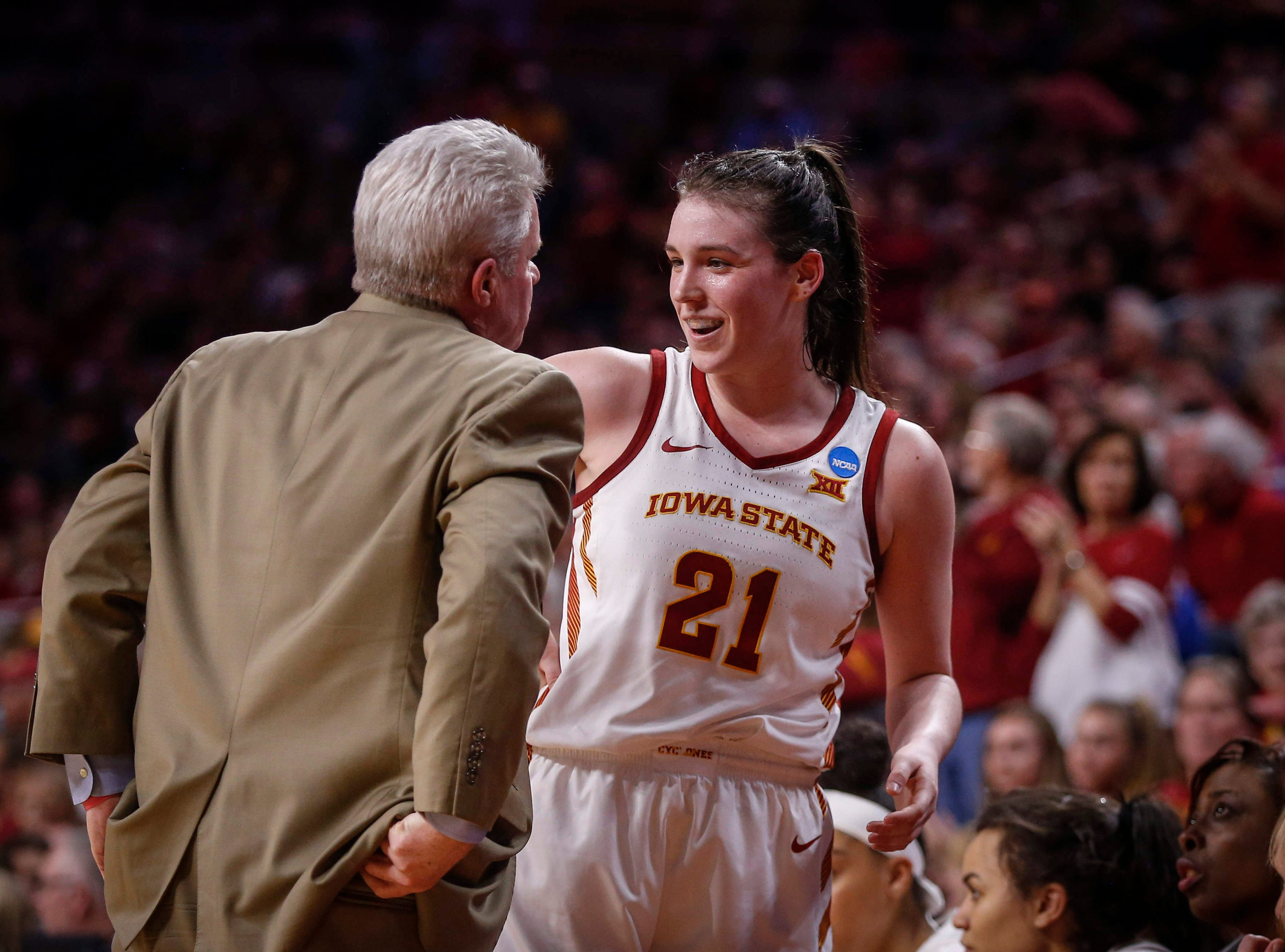 Iowa State senior Bridget Carleton is welcomed to the bench by head coach Bill Fennelly in the fourth quarter against New Mexico State on Saturday, March 23, 2019, at Hilton Coliseum in Ames.
