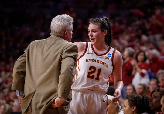 "Iowa State senior Bridget Carleton is welcomed to the bench by head coach Bill Fennelly in the fourth quarter against New Mexico State on Saturday at Hilton Coliseum in Ames, Iowa. ""Bridget is going to go down as one of the best players in Iowa State history,"" Fennelly said Sunday."