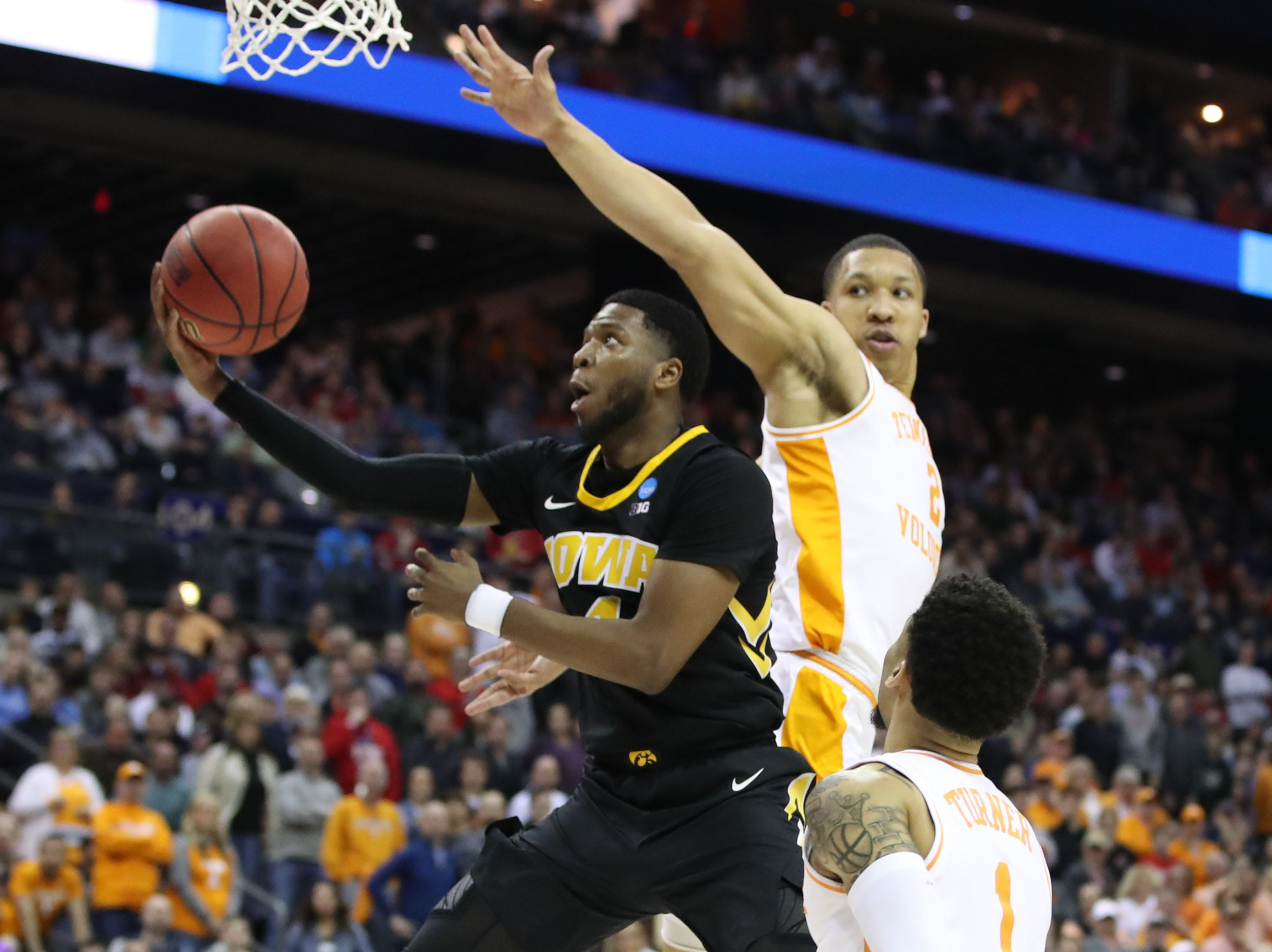 Iowa Hawkeyes guard Isaiah Moss (4) goes to the basket defended by Tennessee Volunteers forward Grant Williams (2) in the second half in the second round of the 2019 NCAA Tournament at Nationwide Arena.
