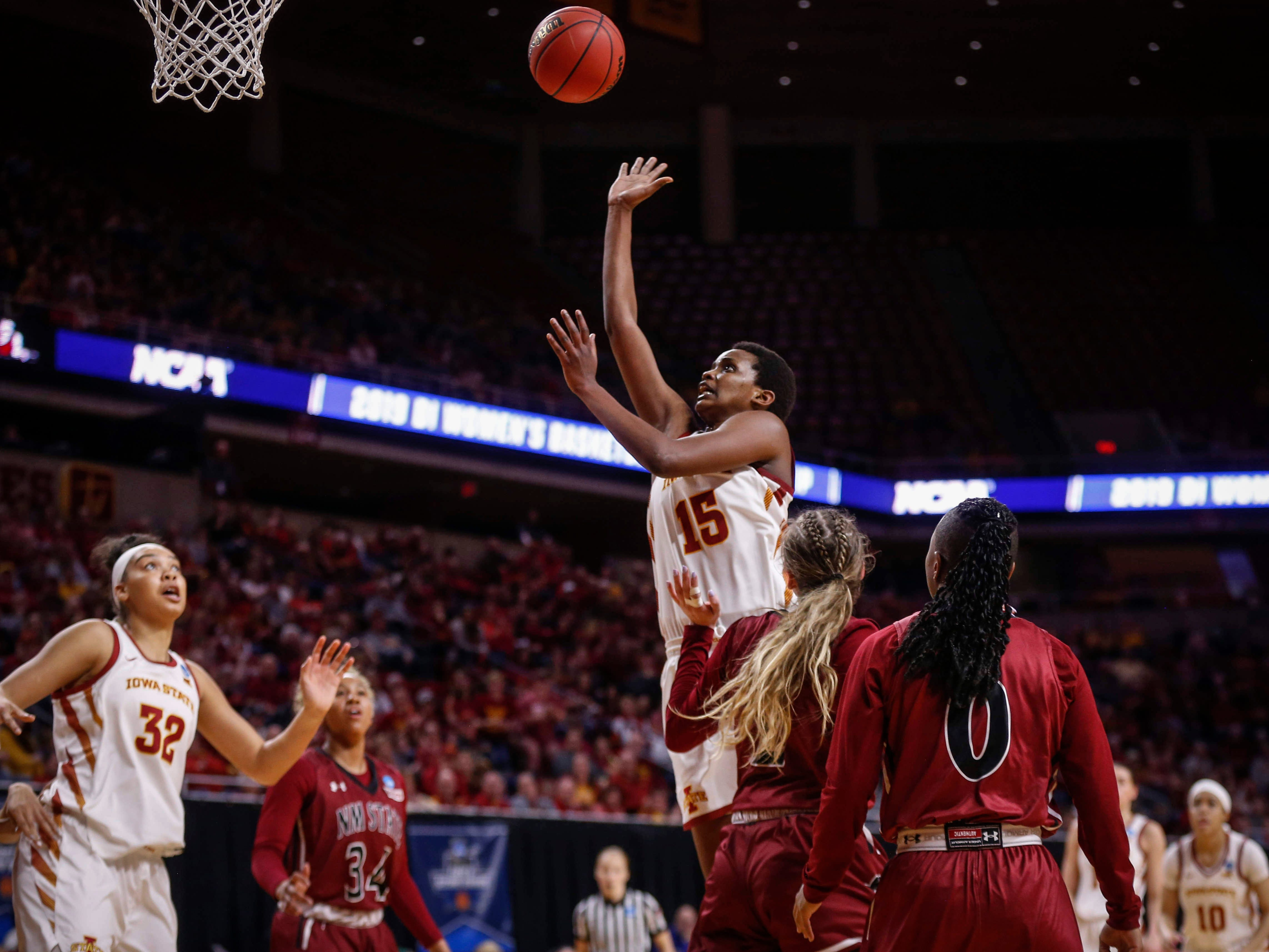 Iowa State senior Ines Nezerwa puts a shot up over New Mexico State senior Brooke Salas in the fourth quarter on Saturday, March 23, 2019, at Hilton Coliseum in Ames.