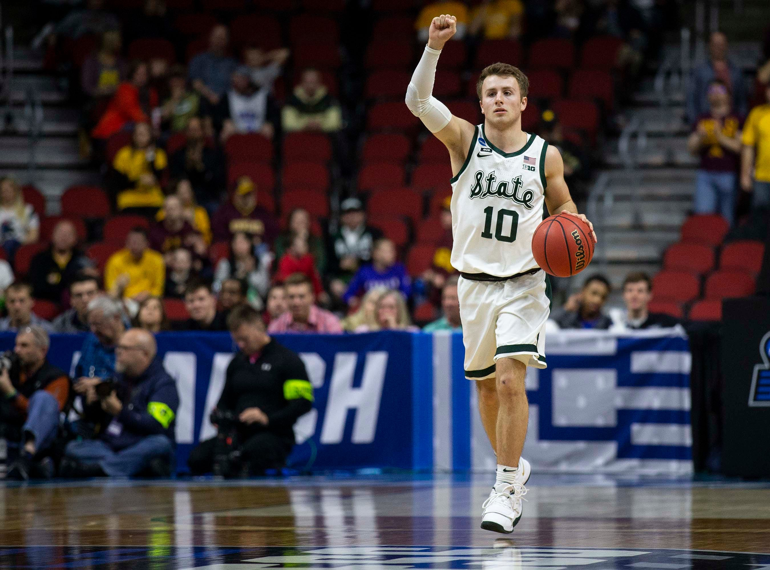 Michigan State's Jack Hoiberg brings the ball down the court during the NCAA Tournament second-round match-up between Minnesota and Michigan State on Saturday, March 23, 2019, in Wells Fargo Arena in Des Moines, Iowa.
