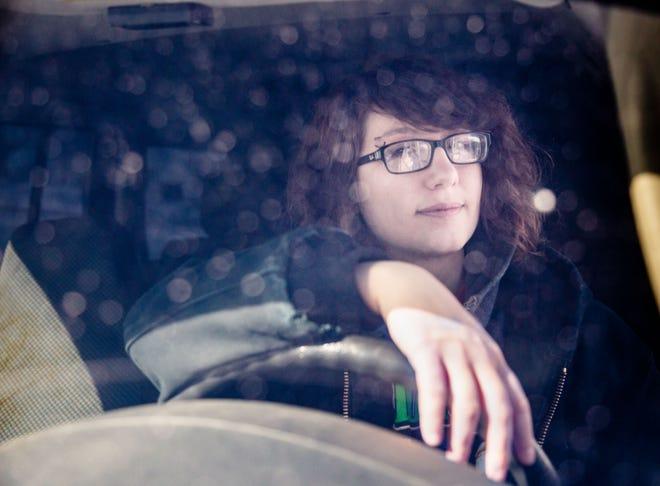 Natasha Daniel sits behind the wheel of her jeep outside her home in Caroll Monday, Feb. 18, 2019.