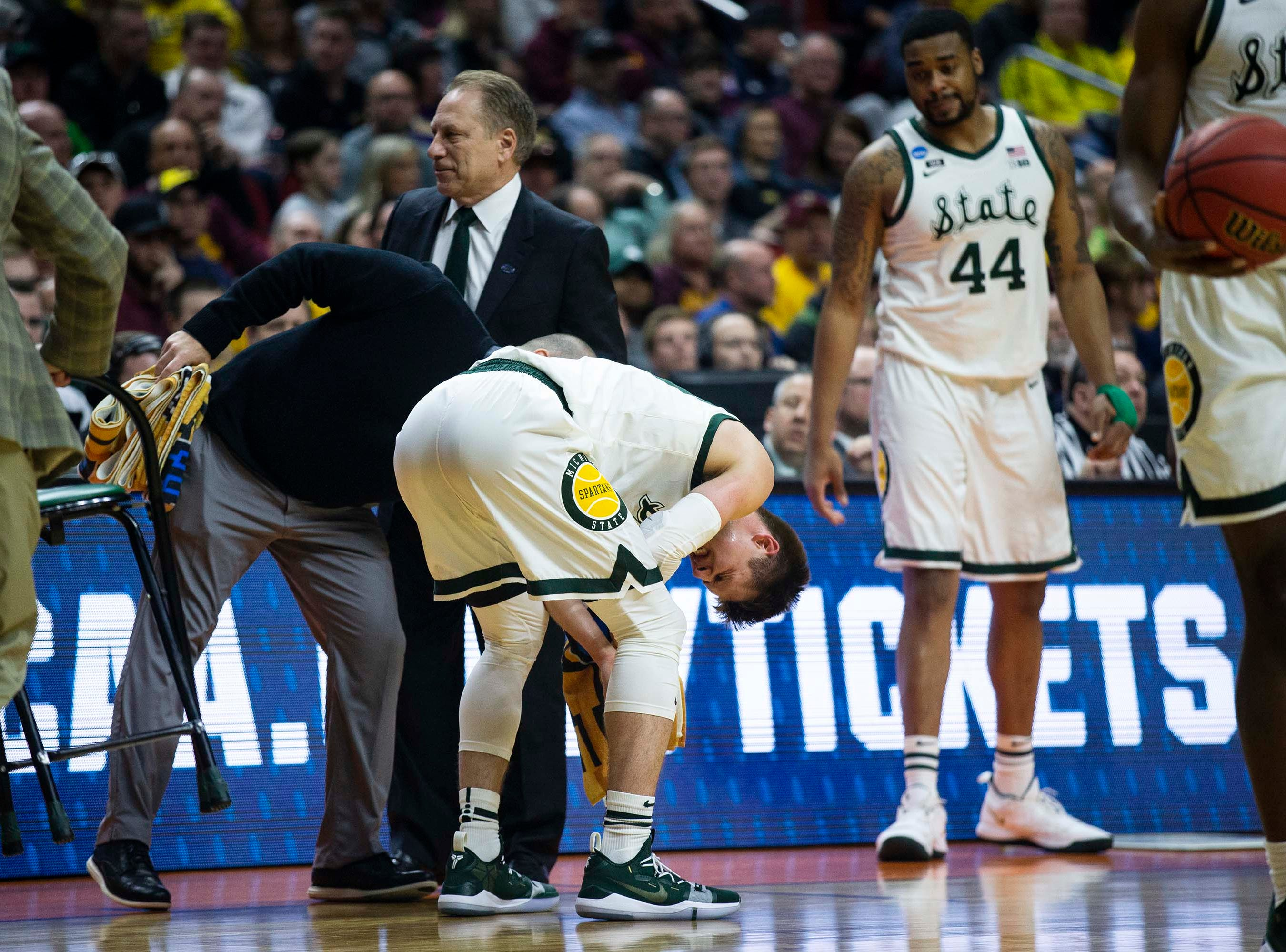 Michigan State's Matt McQuaid reacts to an injury during the NCAA Tournament second-round match-up between Minnesota and Michigan State on Saturday, March 23, 2019, in Wells Fargo Arena in Des Moines, Iowa.