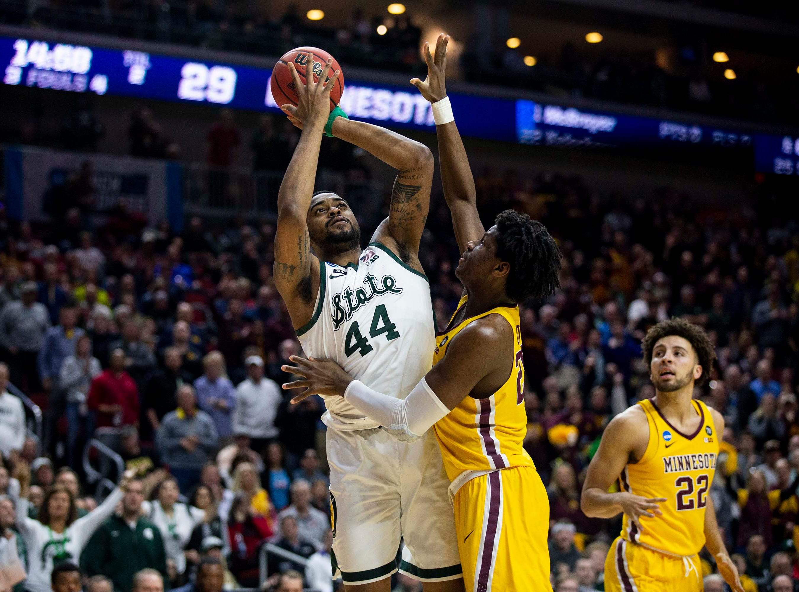 Michigan State's Nick Ward shoots the ball during the NCAA Tournament second-round match-up between Minnesota and Michigan State on Saturday, March 23, 2019, in Wells Fargo Arena in Des Moines, Iowa.