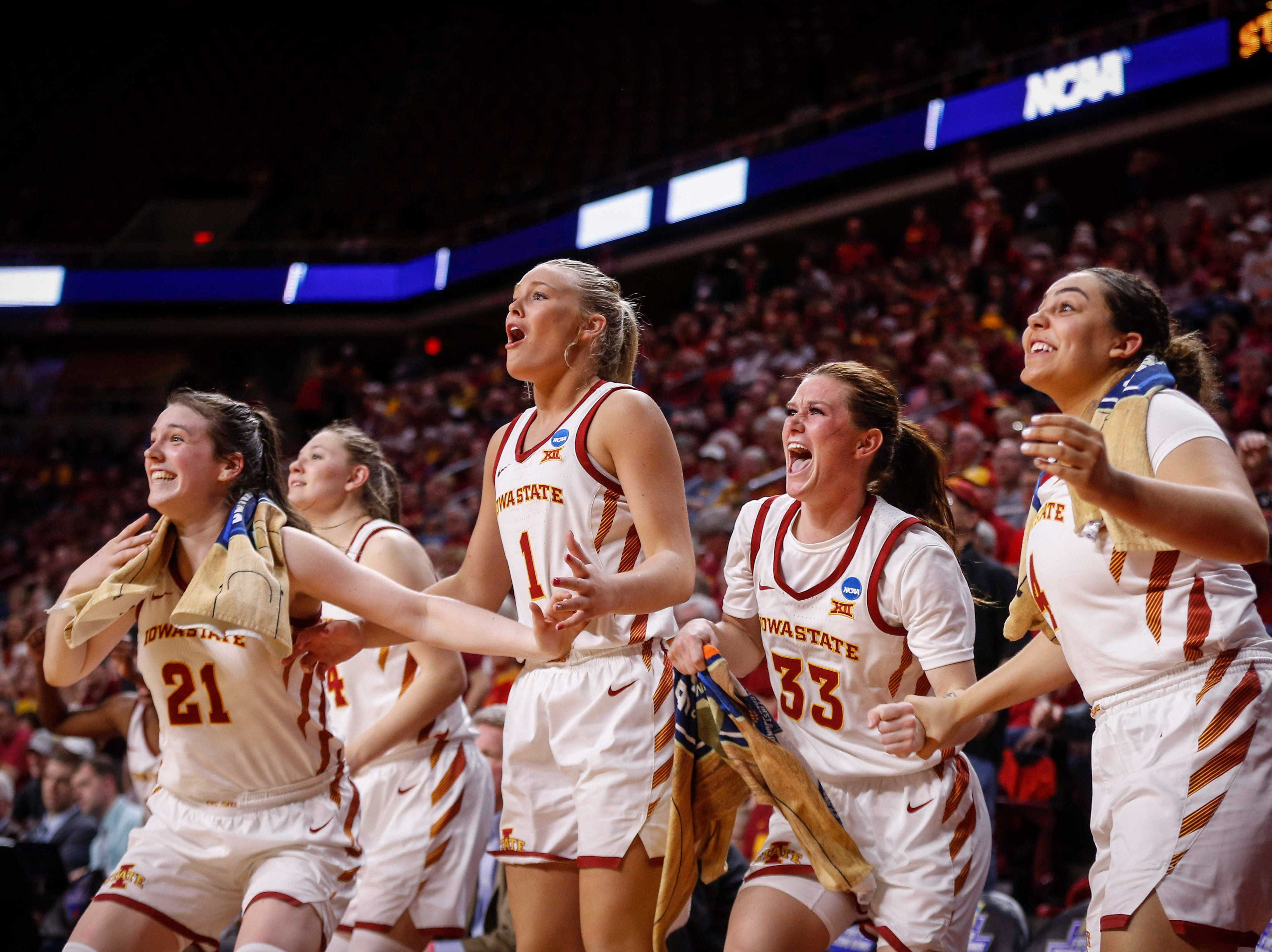 Members of the Iowa State women's basketball team celebrate an NCAA first round win against New Mexico State on Saturday, March 23, 2019, at Hilton Coliseum in Ames.
