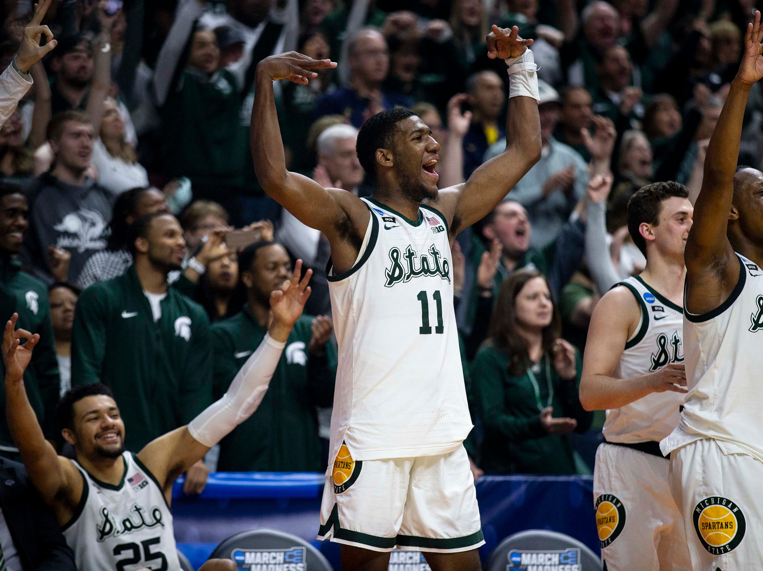 Michigan State's Aaron Henry celebrates from the bench during the NCAA Tournament second-round match-up between Minnesota and Michigan State on Saturday, March 23, 2019, in Wells Fargo Arena in Des Moines, Iowa.