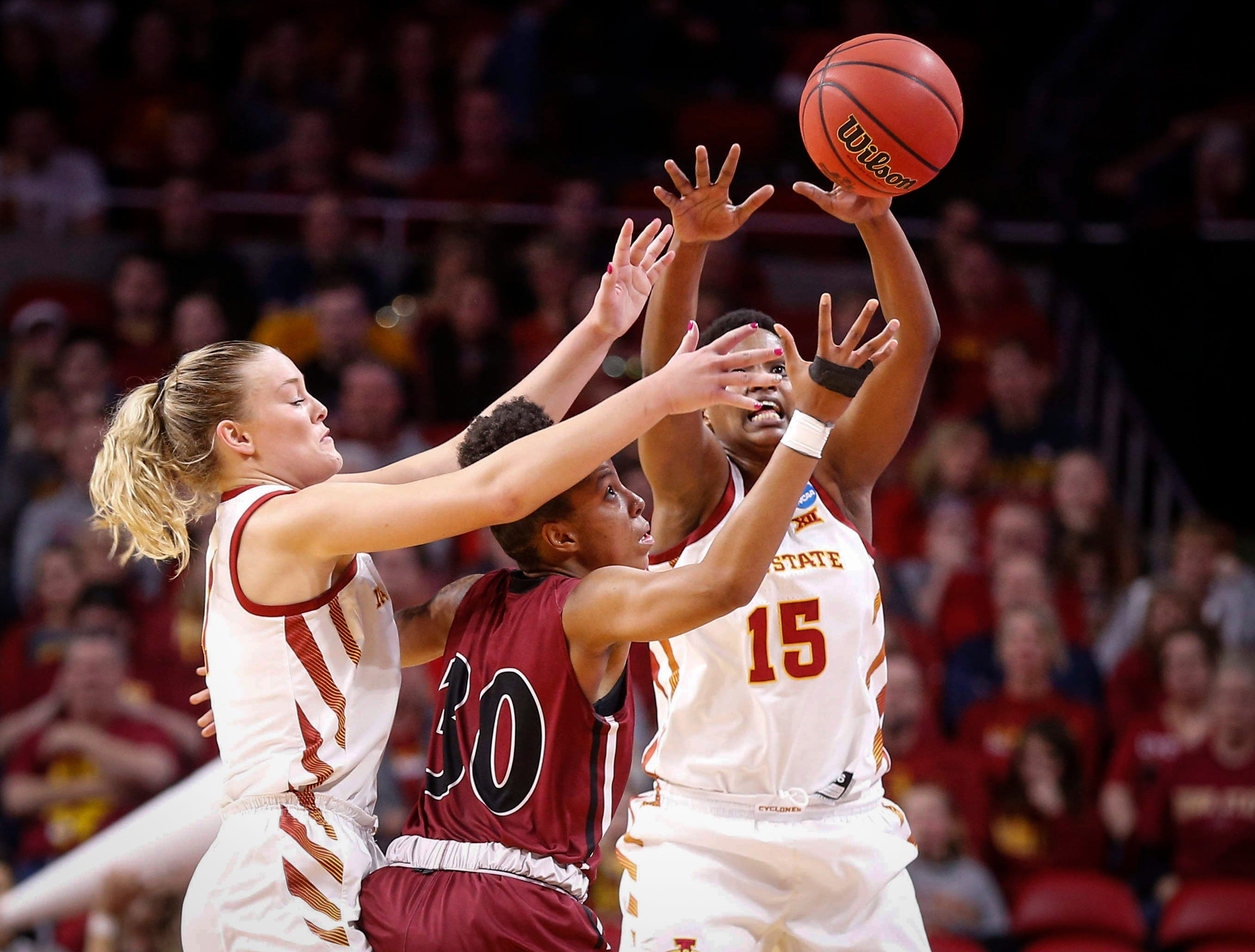 Iowa State's Ashley Joens, left, and Ines Nezerwa play tough defense and force the ball away from New Mexico State junior Gia Pack in the third quarter on Saturday, March 23, 2019, at Hilton Coliseum in Ames.