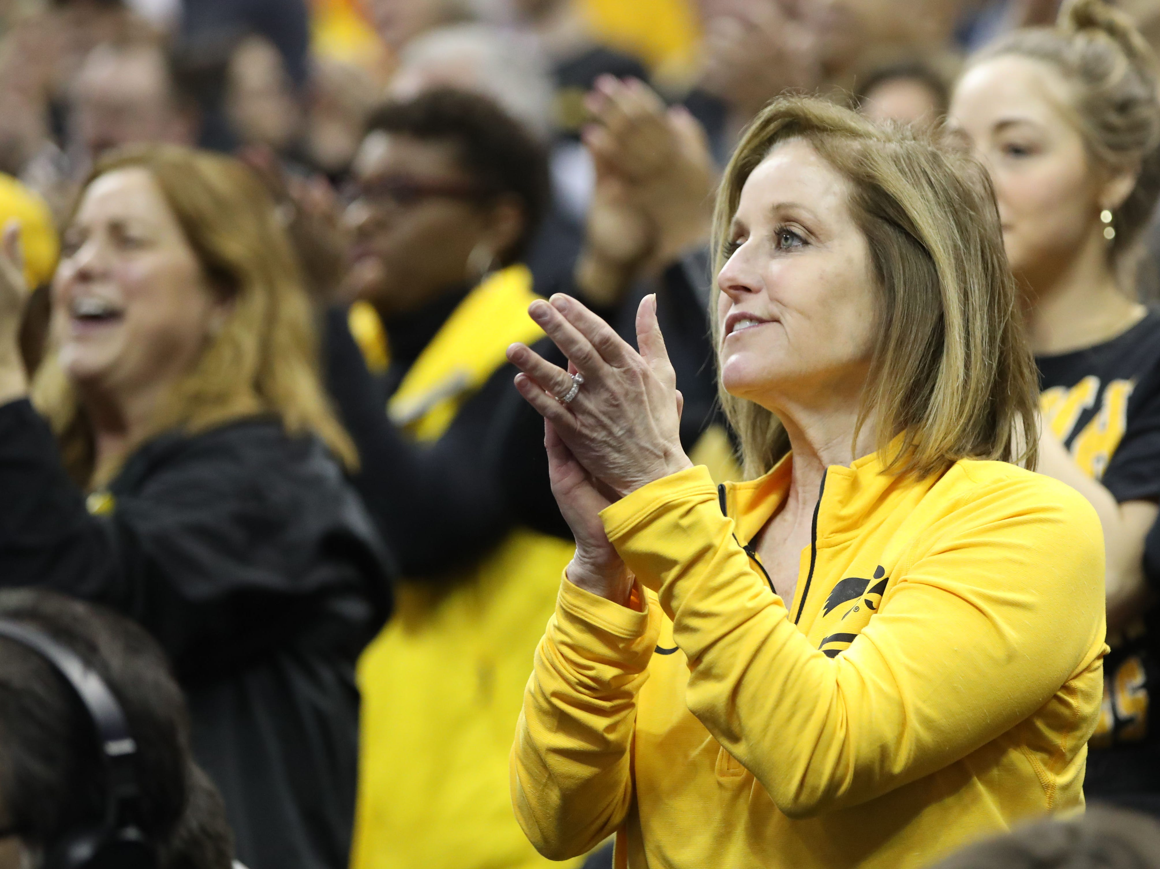 Iowa Hawkeyes fan watch the game against the Tennessee Volunteers in the second round of the 2019 NCAA Tournament at Nationwide Arena.