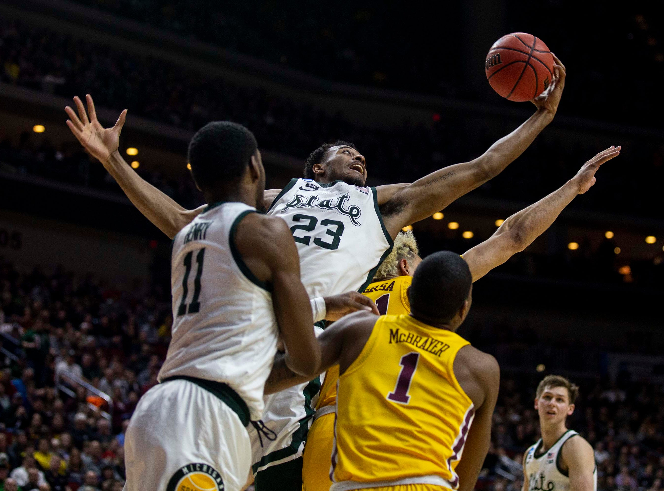 Michigan State's Xavier Tillman tries to keep hold of the ball during the NCAA Tournament second-round match-up between Minnesota and Michigan State on Saturday, March 23, 2019, in Wells Fargo Arena in Des Moines, Iowa.