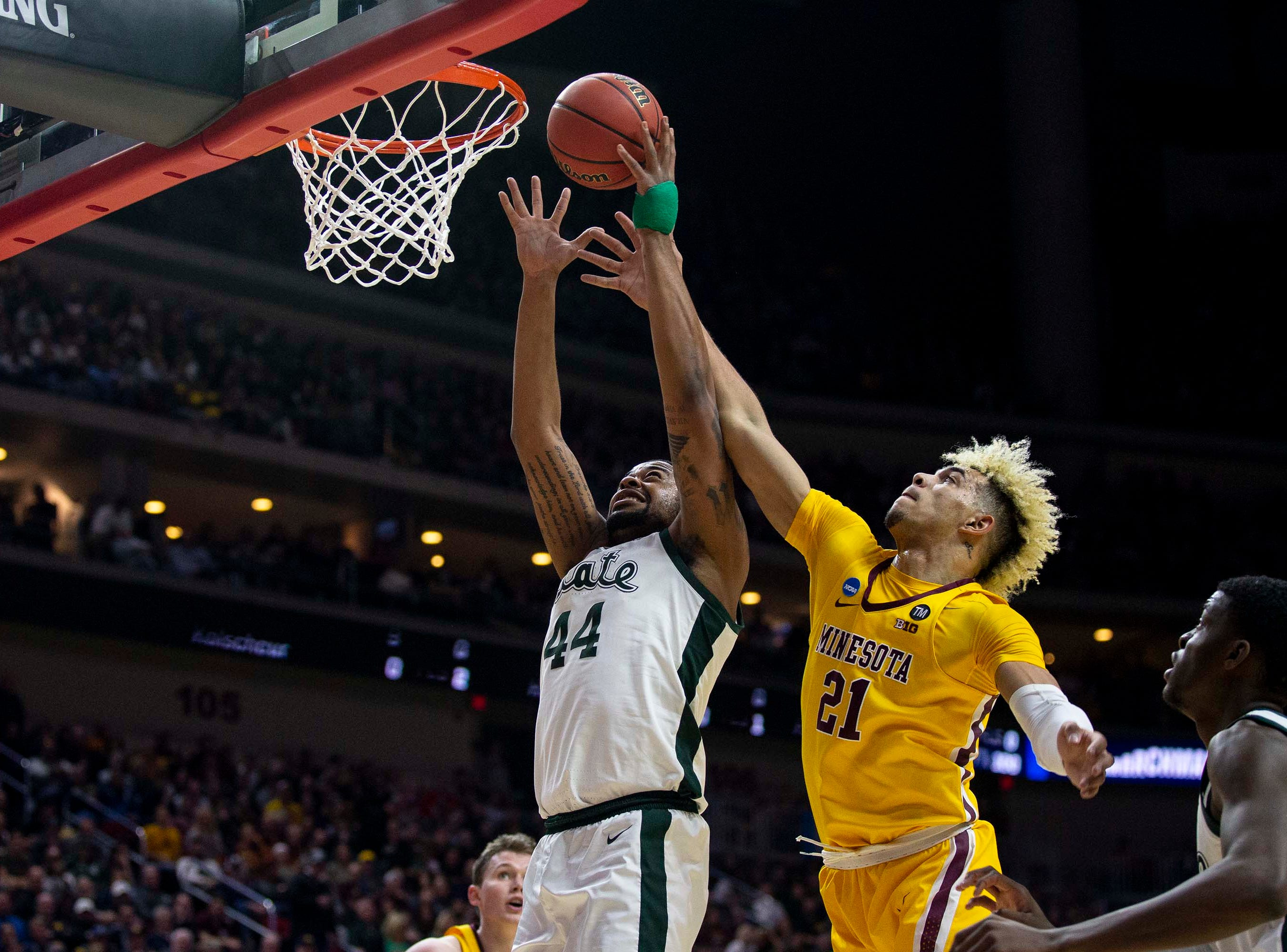 Michigan State's Nick Ward  grabs a rebound during the NCAA Tournament second-round match-up between Minnesota and Michigan State on Saturday, March 23, 2019, in Wells Fargo Arena in Des Moines, Iowa.