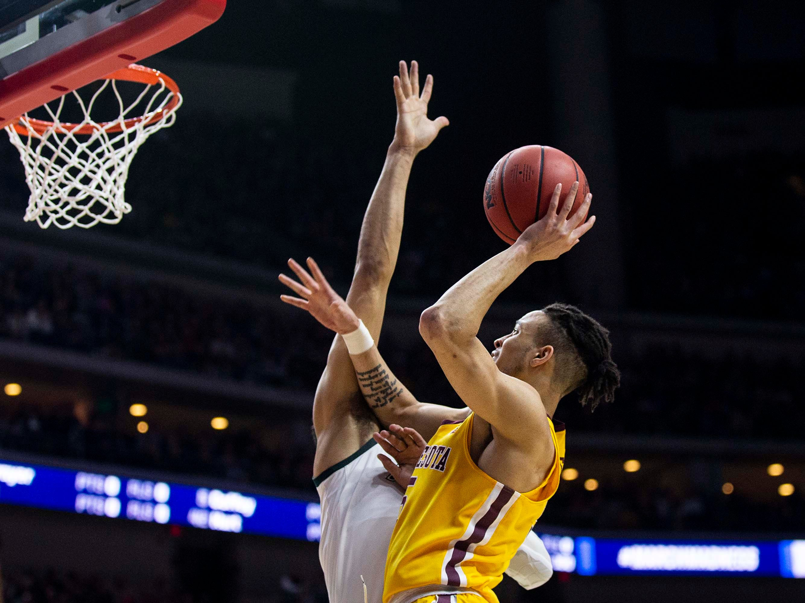 Minnesota's Amir Coffey shoots the ball during the NCAA Tournament second-round match-up between Minnesota and Michigan State on Saturday, March 23, 2019, in Wells Fargo Arena in Des Moines, Iowa.