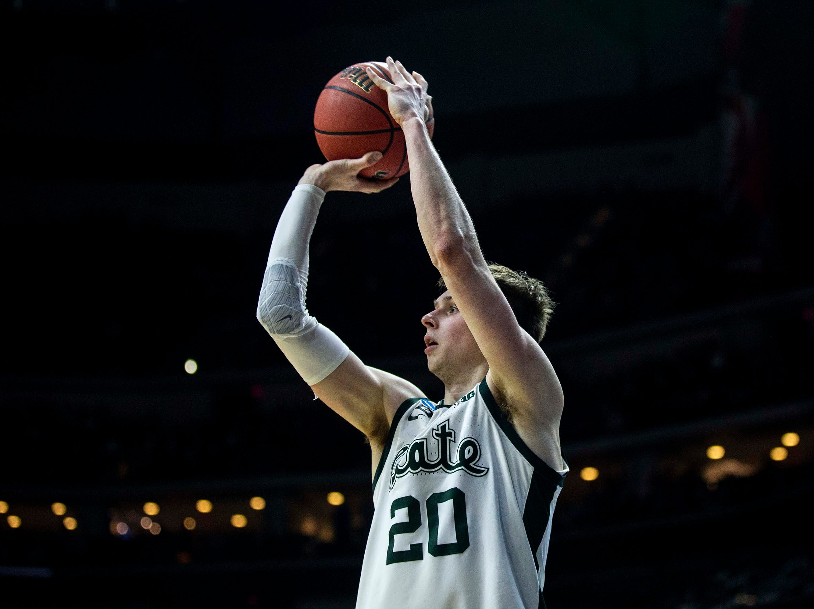Michigan State's Matt McQuaid shoots the ball during the NCAA Tournament second-round match-up between Minnesota and Michigan State on Saturday, March 23, 2019, in Wells Fargo Arena in Des Moines, Iowa.