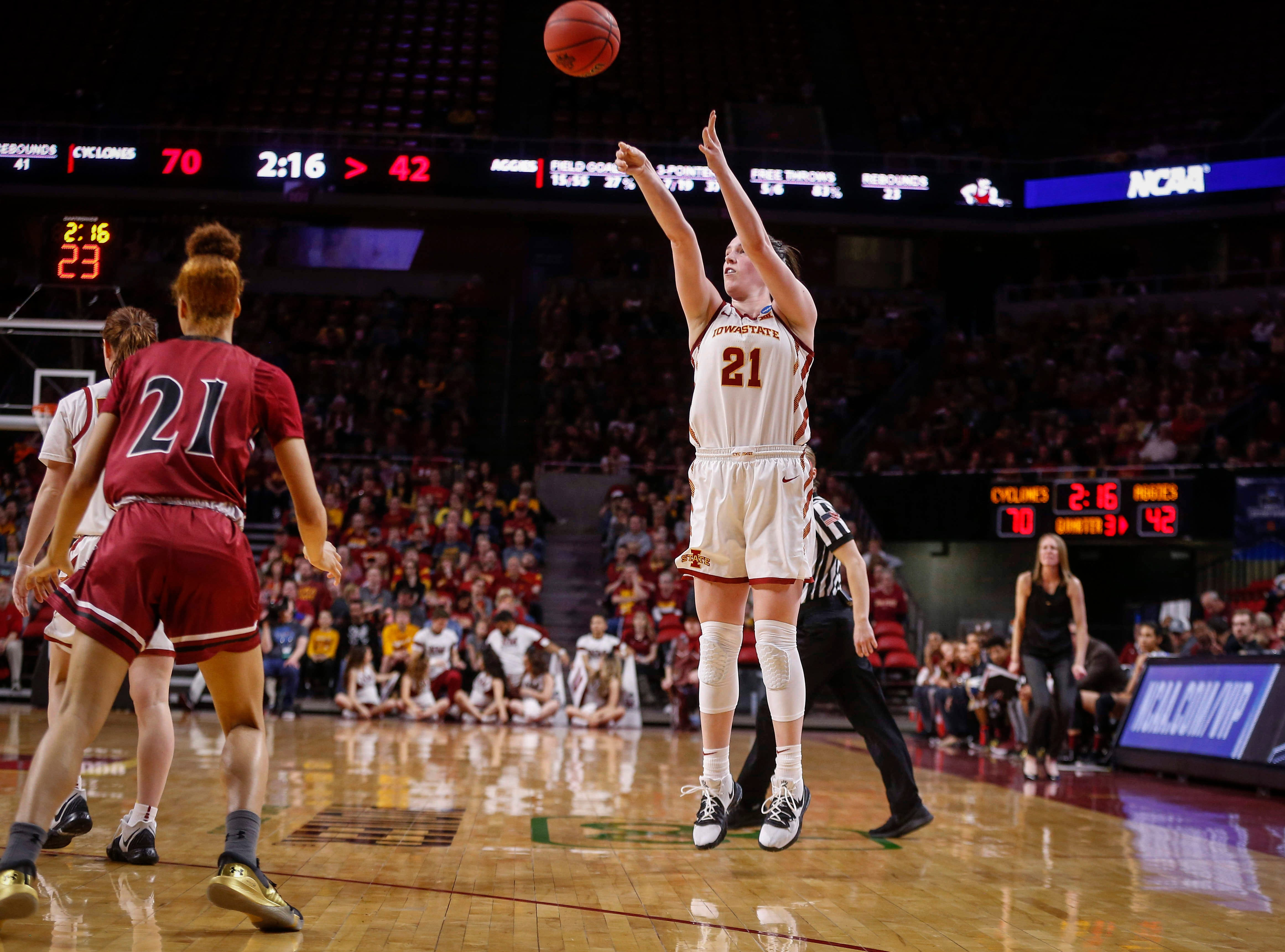 Iowa State senior Bridget Carleton launches a shot from the three point line against New Mexico State on Saturday, March 23, 2019, at Hilton Coliseum in Ames.